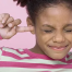 girl protecting her ears from noise with fingers