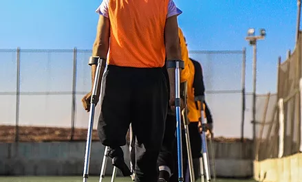 disabled men on crutches